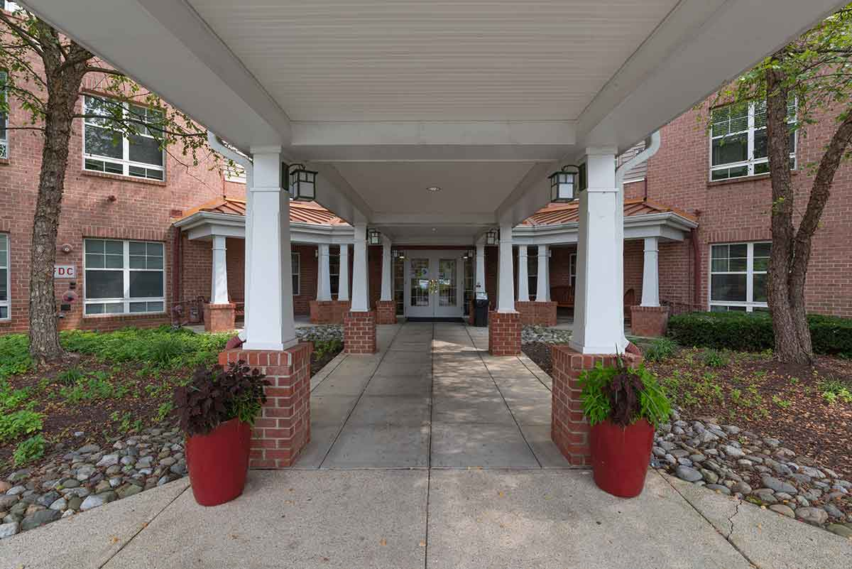 Walkway under awning leading to Victory House of Palmer Park main entrance