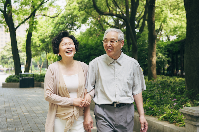 Lighthearted Chinese Seniors Walking at a Shanghai Park